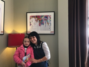 Naomi and her artistic mentor, Carmen, at exposition of art by Naomi and her friends